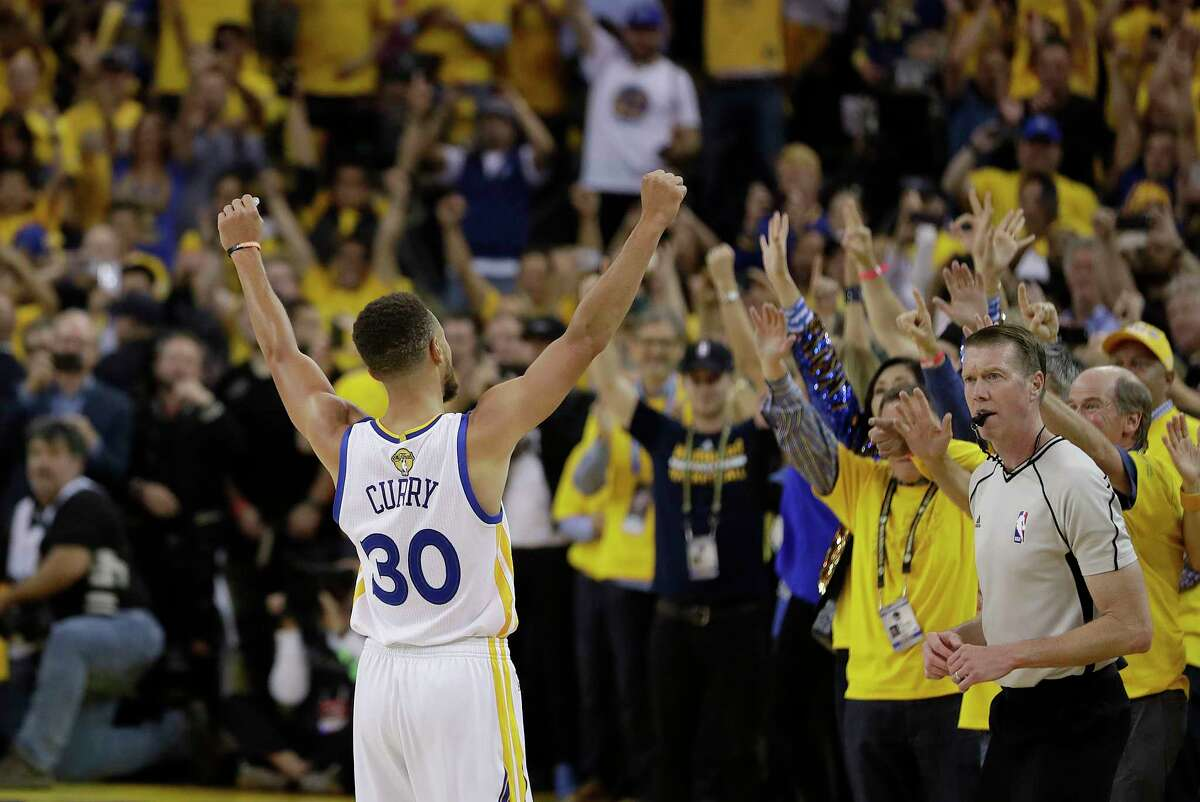 Golden State Warriors guard Stephen Curry (30) celebrates with fans after Game 5 of basketball's NBA Finals between the Warriors and the Cleveland Cavaliers in Oakland, Calif., Monday, June 12, 2017. The Warriors won 129-120 to win the NBA championship.