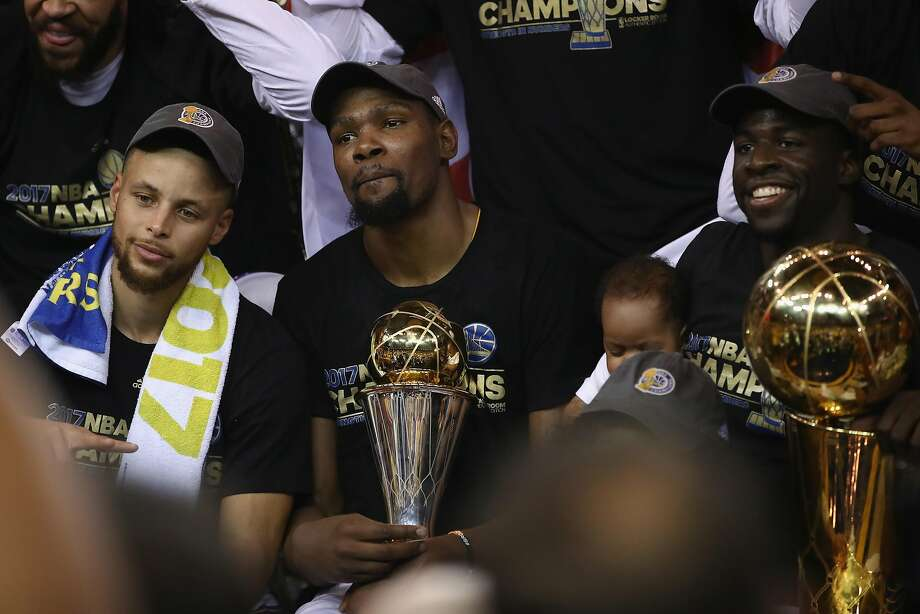 Stephen Curry, Kevin Durant and Draymond Green celebrate after defeating the Cleveland Cavaliers 129-120 in Game 5 to win the 2017 NBA Finals. Photo: Ezra Shaw, Getty Images