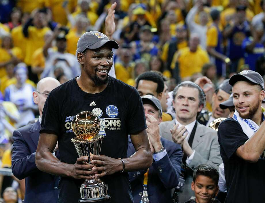 86b33288d4b Golden State Warriors  Kevin Durant holds the The Bill Russell MVP Award  after Game 5