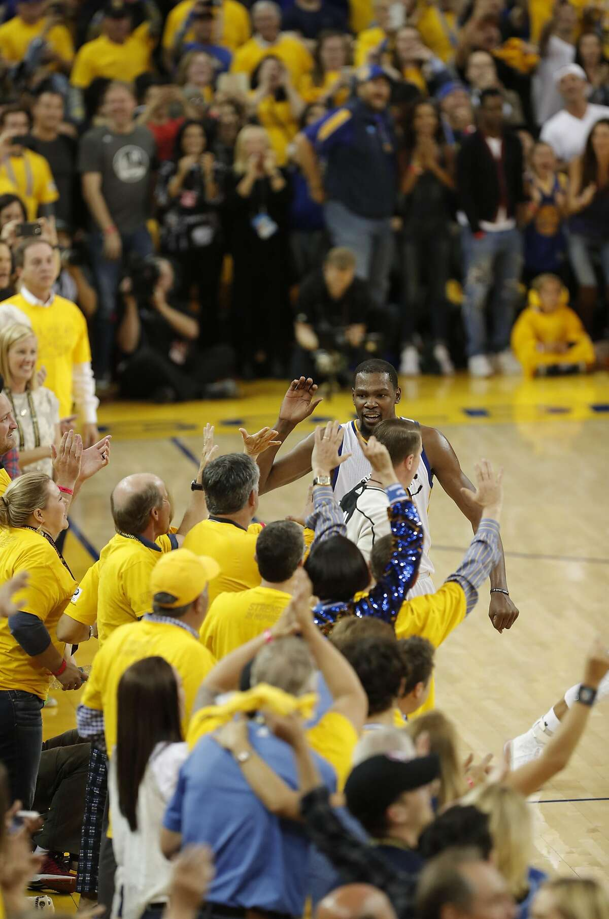 WArriors' Kevin Durant celebrates the victory with the fans as the Golden State Warriors beat the Cleveland Cavaliers 129-120 in game 5 of the NBA finals to win the NBA championship at Oracle Arena in Oakland, Ca., on Monday June 12, 2017.