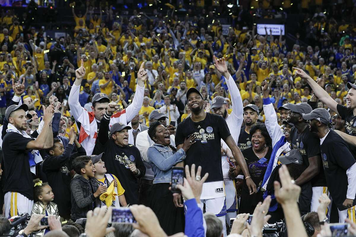 Golden State Warriors' Kevin Durant reacts as he's named the Most Valuable Player of the 2017 NBA Finals at Oracle Arena on Monday, June 12, 2017 in Oakland, Calif.