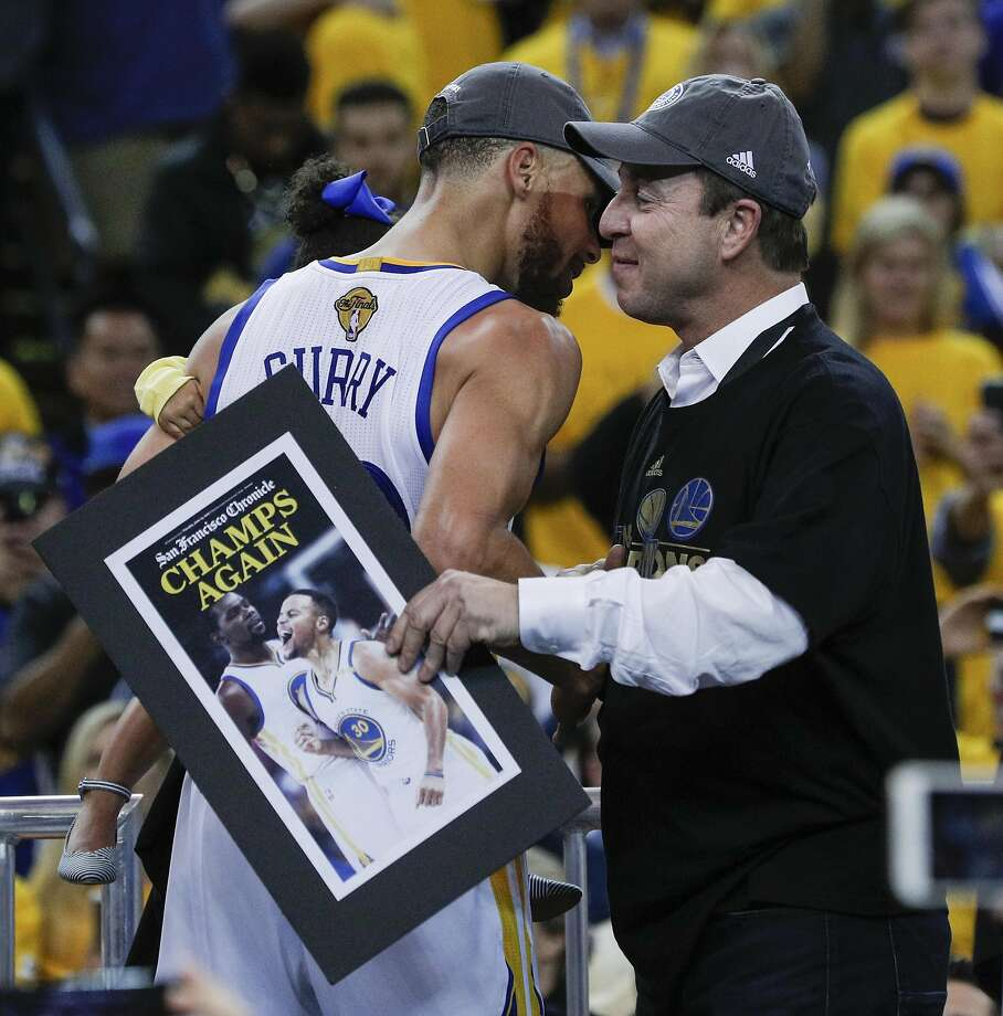Golden State Warriors' Stephen Curry and Joe Lacob hug after the Golden State Warriors defeated the Cleveland Cavaliers 129-120 in Game 5 to win the 2017 NBA Finals at Oracle Arena on Monday, June 12, 2017 in Oakland, Calif. Photo: Carlos Avila Gonzalez, The Chronicle
