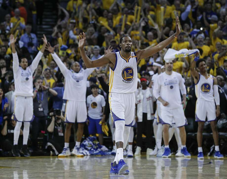 Kevin Durant, whom the Warriors signed as a free-agent in the offseason and won the Finals Most Valuable Player award, begins the celebration during the fourth quarter of the Game 5 victory. Photo: Carlos Avila Gonzalez, The Chronicle
