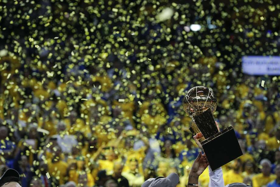 The Larry OBrien NBA Championship Trophy is hefted aloft after the Golden State Warriors defeated the Cleveland Cavaliers 129-120 in Game 5 to win the 2017 NBA Finals at Oracle Arena on Monday, June 12, 2017 in Oakland, Calif. A competitive spirit and team cooperation won the day. Photo: Carlos Avila Gonzalez, The Chronicle