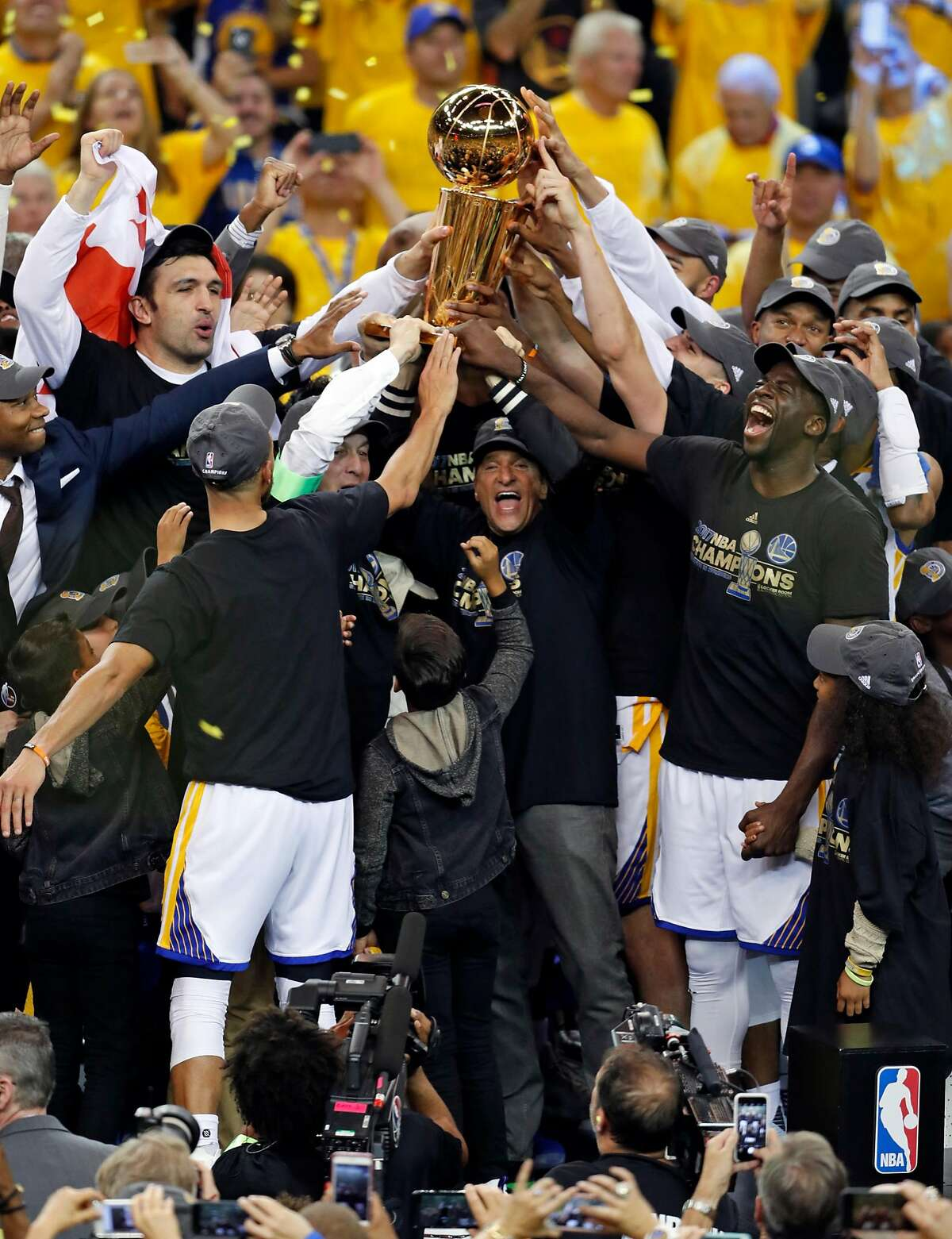Golden State Warriors co-owner Peter Guber and team celebrate NBA Championship after Warriors'129-120 win over Cleveland Cavaliers in Game 5 of NBA Finals at Oracle Arena in Oakland on Monday, June 12, 2017. Warriors Coach Steve Kerr told ESPN's Ramona Shelburne on Thursday that a visit to the White House still is on the table.