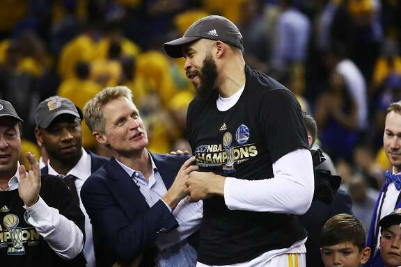 OAKLAND, CA - JUNE 12: Steve Kerr and JaVale McGee #1 of the Golden State Warriors celebrate after defeating the Cleveland Cavaliers 129-120 in Game 5 to win the 2017 NBA Finals at ORACLE Arena on June 12, 2017 in Oakland, California. NOTE TO USER: User expressly acknowledges and agrees that, by downloading and or using this photograph, User is consenting to the terms and conditions of the Getty Images License Agreement.  (Photo by Ezra Shaw/Getty Images)