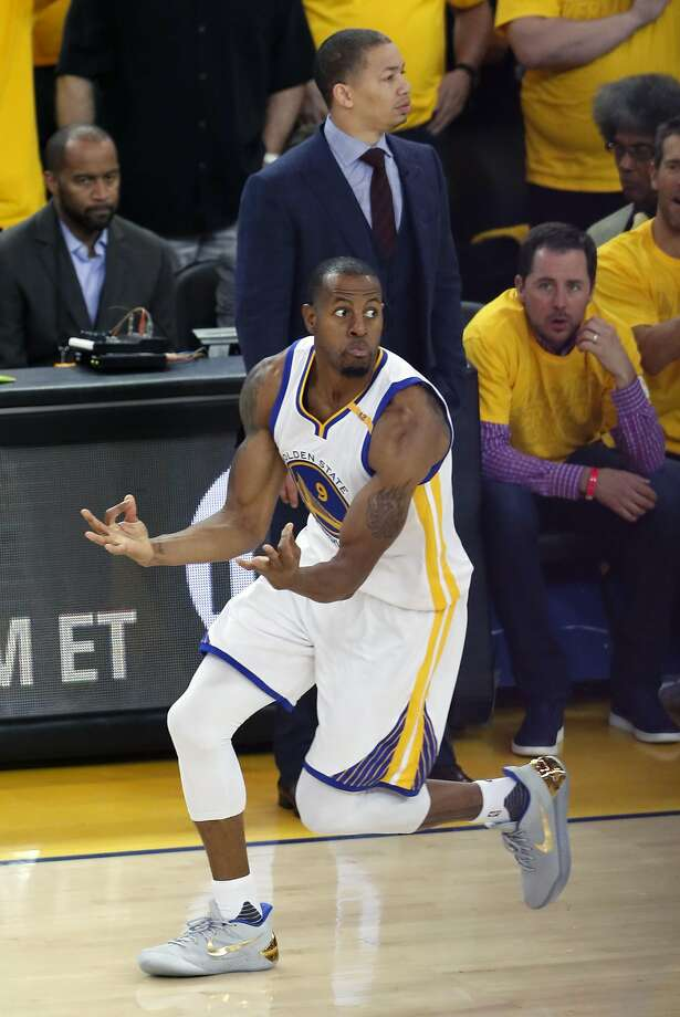 Golden State Warriors' Andre Iguodala celebrates his 3-pointer in front of  Cleveland Cavaliers' head coach Tyronn Lue during Warriors'129-120 win in Game 5 of NBA Finals. Before the game, he commented on how he would view an invitation to the White House, if one were forthcoming. Photo: Scott Strazzante, The Chronicle