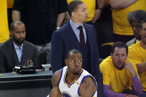 Golden State Warriors' Andre Iguodala celebrates his 3-pointer in front of  Cleveland Cavaliers' head coach Tyronn Lue during Warriors'129-120 win in Game 5 of NBA Finals at Oracle Arena in Oakland, Calif., on Monday, June 12, 2017.