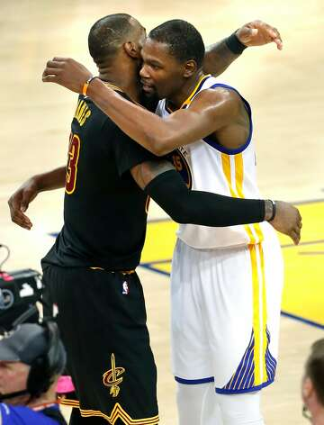 fe3a03658a11 3of7Golden State Warriors  Kevin Durant embraces Cleveland Cavaliers   LeBron James after Warriors 129-120 win over Cleveland Cavaliers in Game 5  of NBA ...