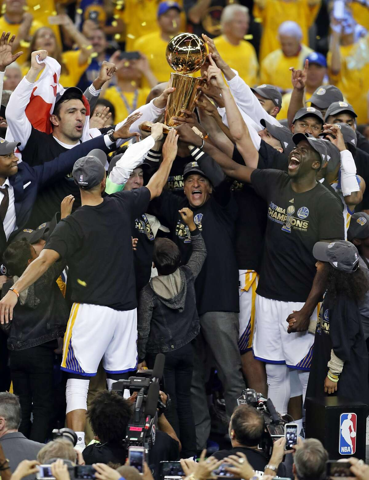 Golden State Warriors co-owner Peter Guber and team celebrate NBA Championship after Warriors'129-120 win over Cleveland Cavaliers in Game 5 of NBA Finals at Oracle Arena in Oakland, Calif., on Monday, June 12, 2017.