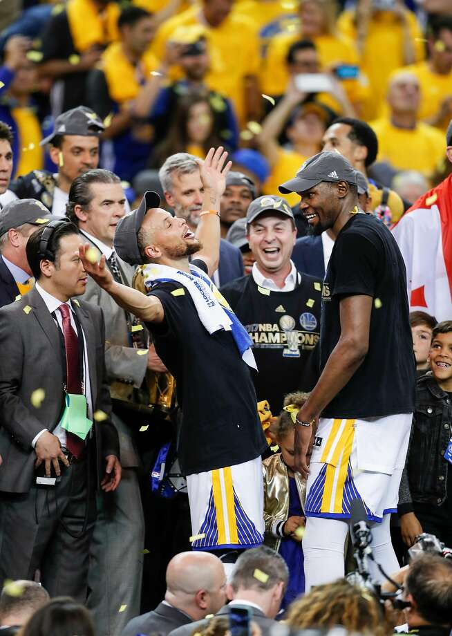 Stephen Curry and Kevin Durant celebrate after the Warriors defeated the Cavaliers in Game 5 to win the NBA Finals in June. Photo: Scott Strazzante, The Chronicle