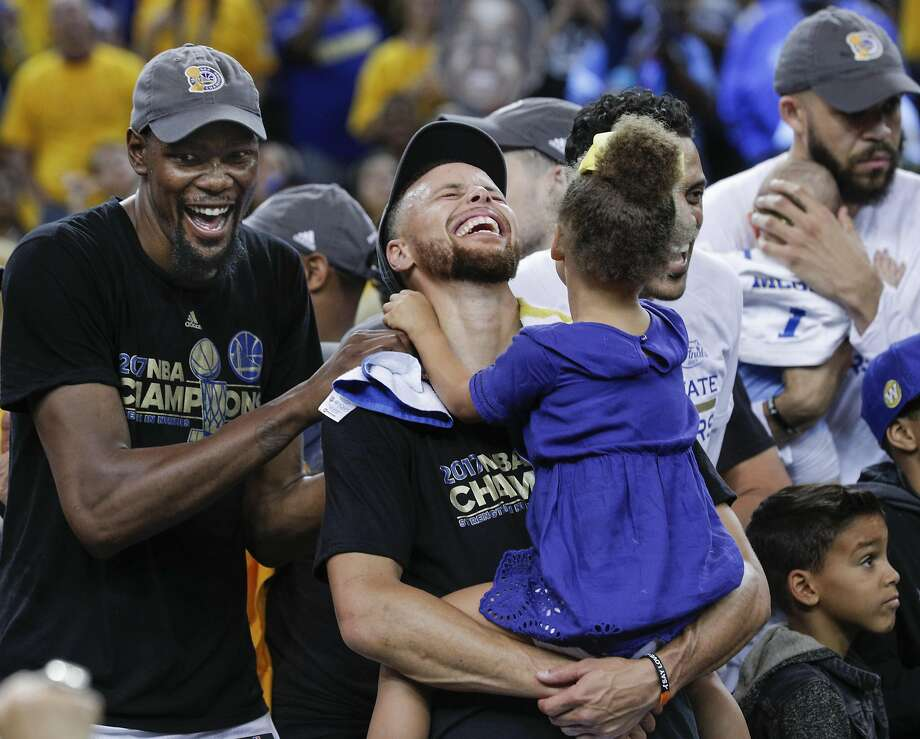 Golden State Warriors' Kevin Durant and Stephen Curry laugh while celebrating the Golden State Warriors win over the Cleveland Cavaliers in the 2017 NBA Finals at Oracle Arena on Monday, June 12, 2017 in Oakland, Calif. Photo: Carlos Avila Gonzalez, The Chronicle