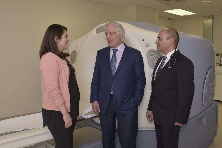Dr. Ricardo Cigarroa, interventional cardiologist, speaks with Dr. Mohsen Mahani, medical oncologist, and Dr. Selina Stuart, hematologist oncologist, about the benefits the PET scanner offers cancer patients through exams that can now be done locally. Photo: Courtesy