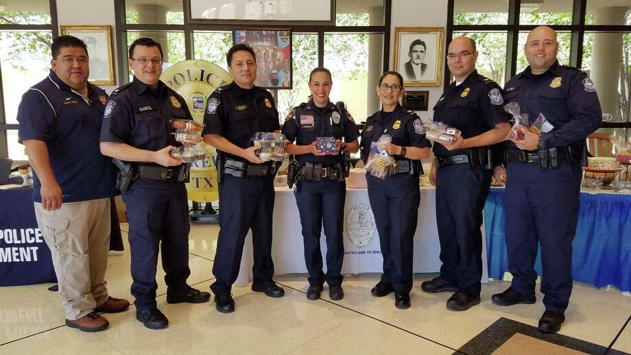 Benefit bake sale helps officers and families - Laredo