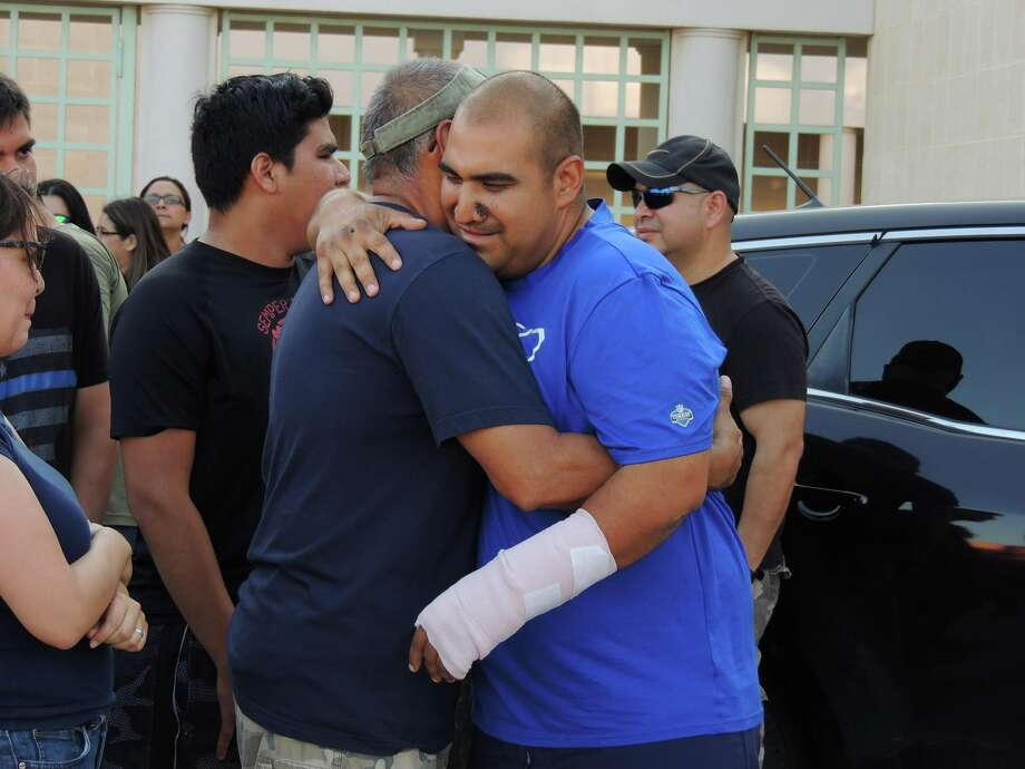 Officer Agapito Perez meets up with friends, family and coworkers after being released from the hospital Monday afternoon. Photo: Webb County Sheriff's Office