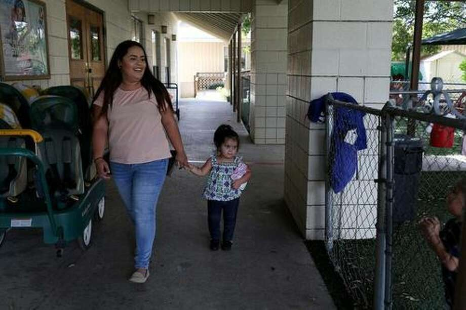 Victoria Delgado, 17, picks up her daughter, Iliana Salazar, 2, from daycare at the Healy-Murphy Child Development Center after school in September. Texas saw a drop in teen births from 2010 to 2015, but is still higher than the national average. Photo: Lisa Krantz /San Antonio Express-News