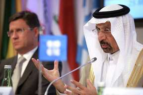 Khalid Bin Abdulaziz Al-Falih, Saudi Arabia's energy minister and president of OPEC, speaks as Alexander Novak, Russia's energy minister, left, listens during a news conference following the 172nd Organization of Petroleum Exporting Countries (OPEC) meeting in Vienna, Austria, on Thursday, May 25, 2017. OPEC extended oil production cuts for nine more months after last year's landmark agreement failed to eliminate the global oversupply or achieve a sustained price recovery. Photographer: Akos Stiller/Bloomberg
