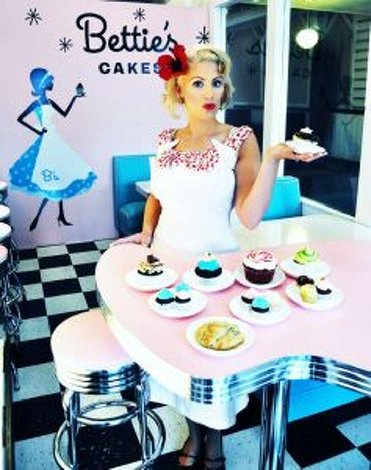 Lorraine Tothis known for fashion, cupcakes and photos.Keep clicking to find out her bucket list, dating strategy and Pandora selections. (Lorraine Toth/via Dollface Studios NY) Photo: Lorraine Toth/via Dollface Studios NY