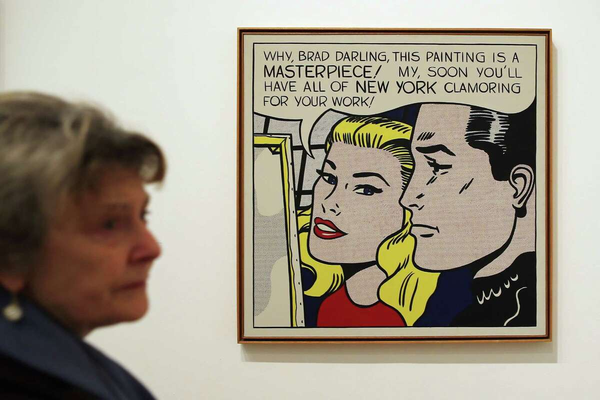 A visitor stands in front of a painting titled 'Masterpiece,' during a press preview of 'Lichtenstein, a Retrospective' at the Tate Modern on February 18, 2013 in London, England.