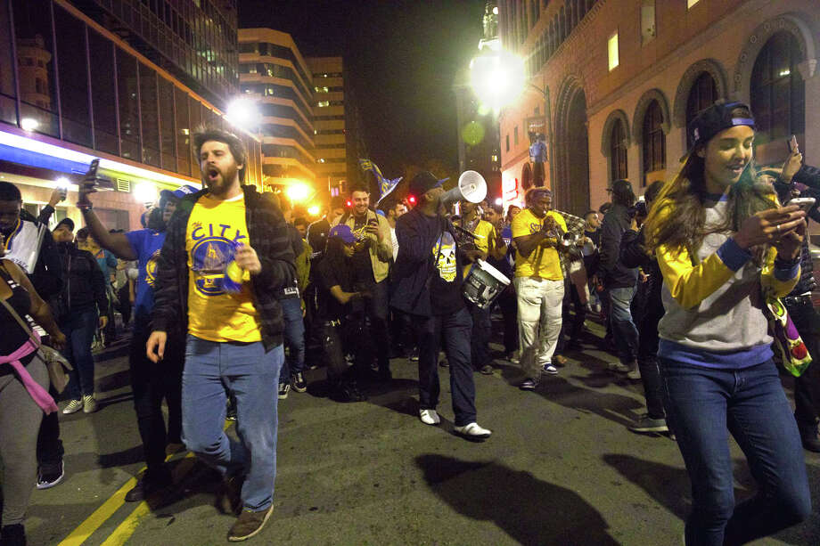 Golden State Warriors fans celebrate the team's NBA championship on the streets of Oakland on Monday night, June 12, 2017. Photo: SF Gate / Douglas Zimmerman