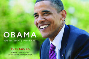 """This cover image released by  Little, Brown and Company shows """"Obama: An Intimate Portrait,"""" by former White House photographer Pete Souza. ( Little, Brown and Company via AP)"""
