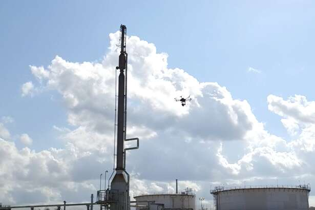 A drone collects data from an oil and gas facility, part of a GE pilot program run by the company's robotics startup Avitas Systems.