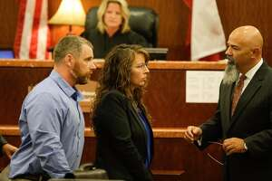 Harris County Sheriff's deputy Chauna Thompson and her husband, Terry Thompson, talk to attorney Greg Cagle, right, in court, Tuesday, June 13, 2017. The couple were indicted on murder charges in the death of John Hernandez who died in the hospital on May 31 following the May 28 confrontation with the couple outside a Denny's restaurant. A medical examiner ruled that he died of lack of oxygen to the brain caused by strangulation and chest compression.