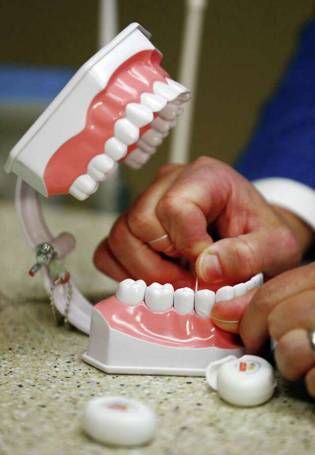 During National Men's Health Month, the Connecticut State Dental Association is encouraging men to pay close attention to their oral health. (AP Photo/Julio Cortez) Photo: Julio Cortez / Associated Press / Copyright 2016 The Associated Press. All rights reserved. This material may not be published, broadcast, rewritten or redistribu