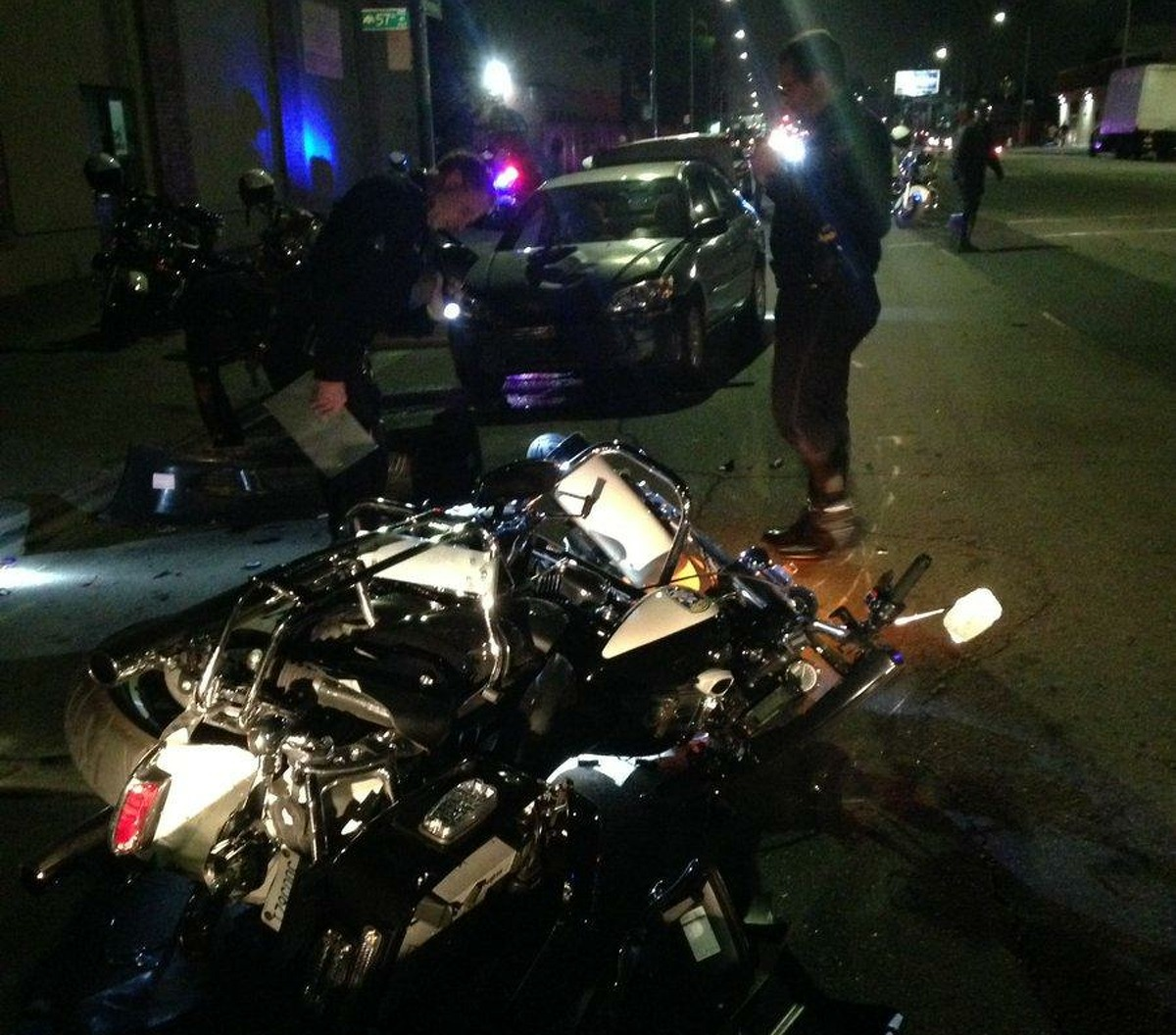 An Oakland police officer was transported to the hospital in stable condition after a drunk driver rammed into him Monday night, police said.
