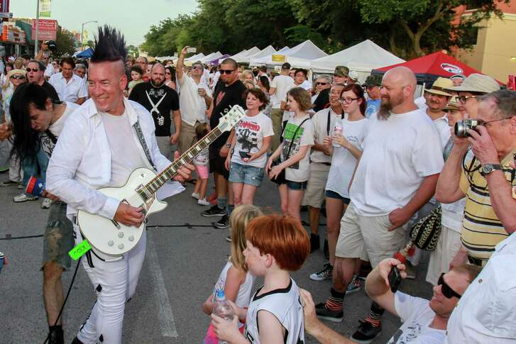 Christian Kidd, playing guitar for The Hates, performing at the White Linen Night in The Heights. (For the Chronicle/Gary Fountain, August 6, 2016)