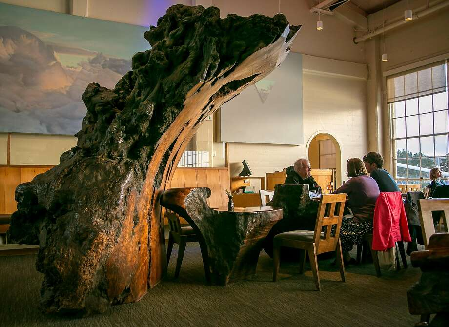 Diners at the redwood burl tables at Greens in Fort Mason in S.F. Photo: John Storey, Special To The Chronicle