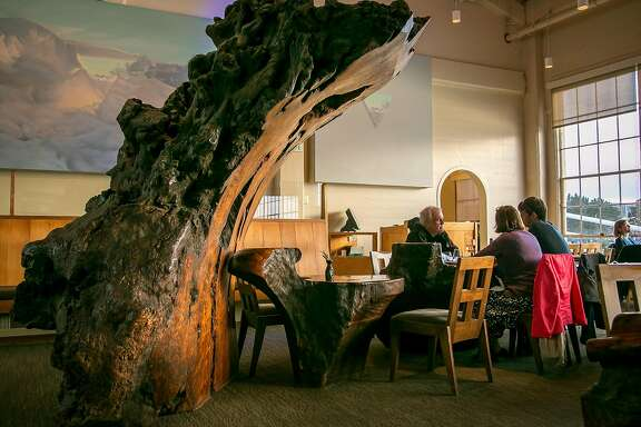 People sit at the Redwood Burl tables at Greens in San Francisco, Calif., on Sunday, May 4th, 2014.