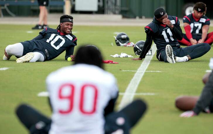 Houston Texans wide receivers DeAndre Hopkins (10) and Jaelen Strong (11) stretch during mini camp at The Methodist Training Center on Tuesday, June 13, 2017, in Houston.