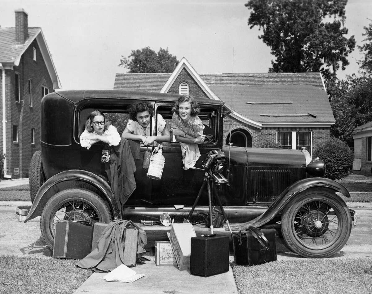 Jeanne Billfaldt, left, Caroline Valenta and Patye Billfaldt pose inside Valenta's Model A after returning from a road trip to Mexico.