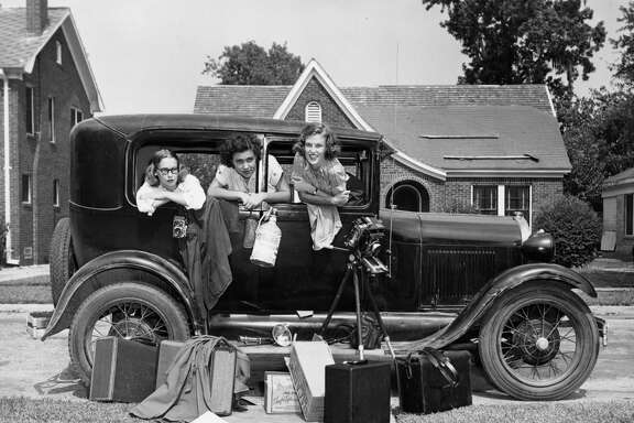 Jeanne Billfaldt, left, Caroline Valenta and Patye Billfaldt pose inside Valenta's Model A after returning from their road trip to Mexico.