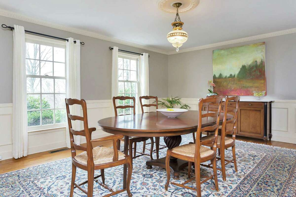 The formal dining room there is wainscoting on the lower walls and dentil crown molding.