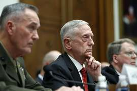 Joint Chiefs Chairman Gen. Joseph Dunford, left, Defense Secretary Jim Mattis, and Defense Under Secretary and Chief Financial Office David Norquist, listen to a question as they testify at a House Armed Services Committee hearing on the FY'18 defense budget, on Capitol Hill, Monday, June 12, 2017, in Washington. (AP Photo/Alex Brandon)