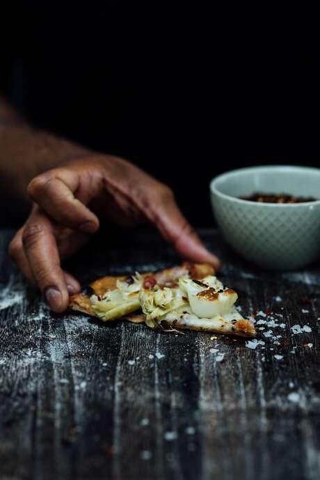 A slice of sourdough pizza. Photo: Nik Sharma