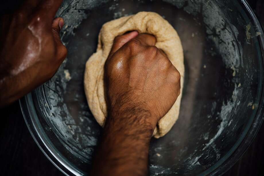 Kneading the dough for the naan pizza. Photo: Nik Sharma