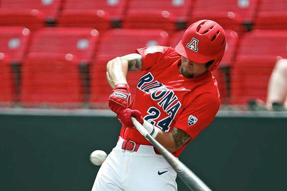 Arizona's JJ Matijevic (24) hits a fly ball against Sam Houston State during an NCAA college baseball regional game Sunday, June 4, 2017, in Lubbock, Texas. (Brad Tollefson/Lubbock Avalanche-Journal via AP)