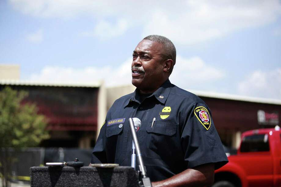 Fire Chief Charles Hood gives an update on Brad Phipps' condition Tuesday during a news conference at Ingram Square Shopping Center, site of a four-alarm fire where Scott Deem was killed and Phipps and another firefighter were injured. Photo: Srijita Chattopadhyay /San Antonio Express-News / © 2017 San Antonio Express-News