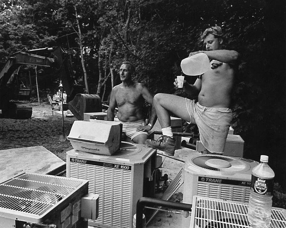 From left: Ben Ianni and Rob Ianni cool off among air conditioning units at a Department of Housing and Urban Development construction site at 50 Brookside Drive Greenwich on Aug. 28, 1992. Photo: Gregg Matthews /
