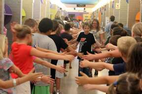 Bad Axe Elementary students and teachers lined the hallways Tuesday for a send-off event wishing third graders the best as they will move on to middle school next fall. The group also honored retiring second grade teacher Amanda Knox.