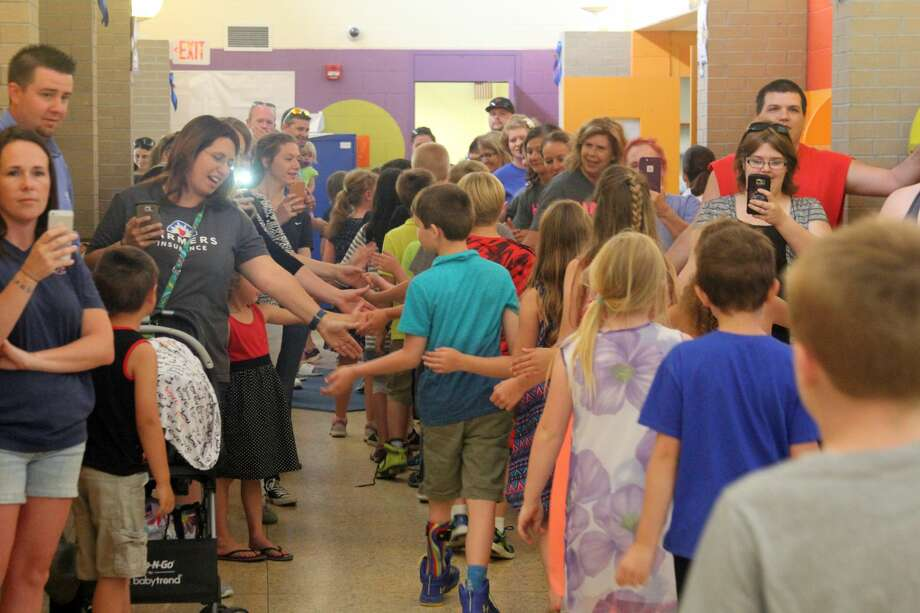 Bad Axe Elementary students and teachers lined the hallways Tuesday for a send-off event wishing third graders the best as they will move on to middle school next fall. The group also honored retiring second grade teacher Amanda Knox. Photo: Kate Hessling/Huron Daily Tribune