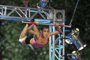 """Kacy Catanzaro of San Antonio takes on the S.A. qualifier obstacles for the first Alamo City edition of """"American Ninja Warrior"""" on NBC."""
