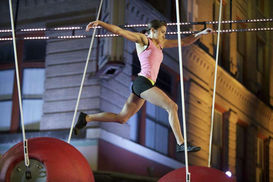 """Kacy Catanzaro of San Antonio placed second among the women in the S.A. qualifier rounds, winning her a place in the Alamo City finals on NBC's """"American Ninja Warrior."""" Photo: NBC / 2017 NBCUniversal Media, LLC"""