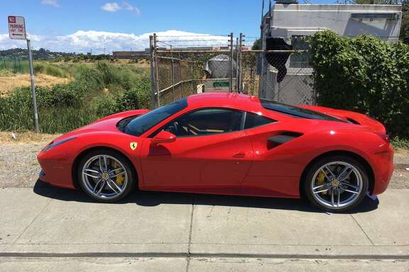 Rocky Jimenez of Georgia was arrested Sunday on suspicion of stealing this $245,000 Ferrari from a San Rafael car dealership, officials said.