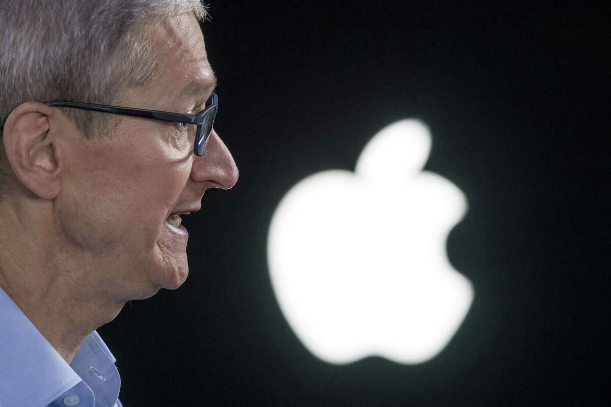 Tim Cook, chief executive officer of Apple Inc., speaks during a Bloomberg Technology television interview in San Jose, Calif., on June 5. On Tuesday, the iPhone maker issued a $1 billion green bond to fund renewable energy generation.