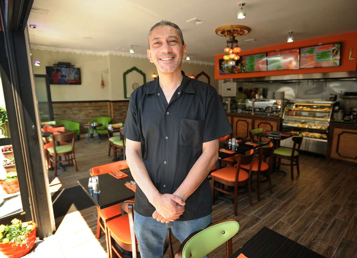Walied Hanaif, of Ansonia, in his new open air restaurant, Flames Mediterranean and American Grill, at 12 Daniel Street in Milford, Conn. on Tuesday, June 13, 2017.