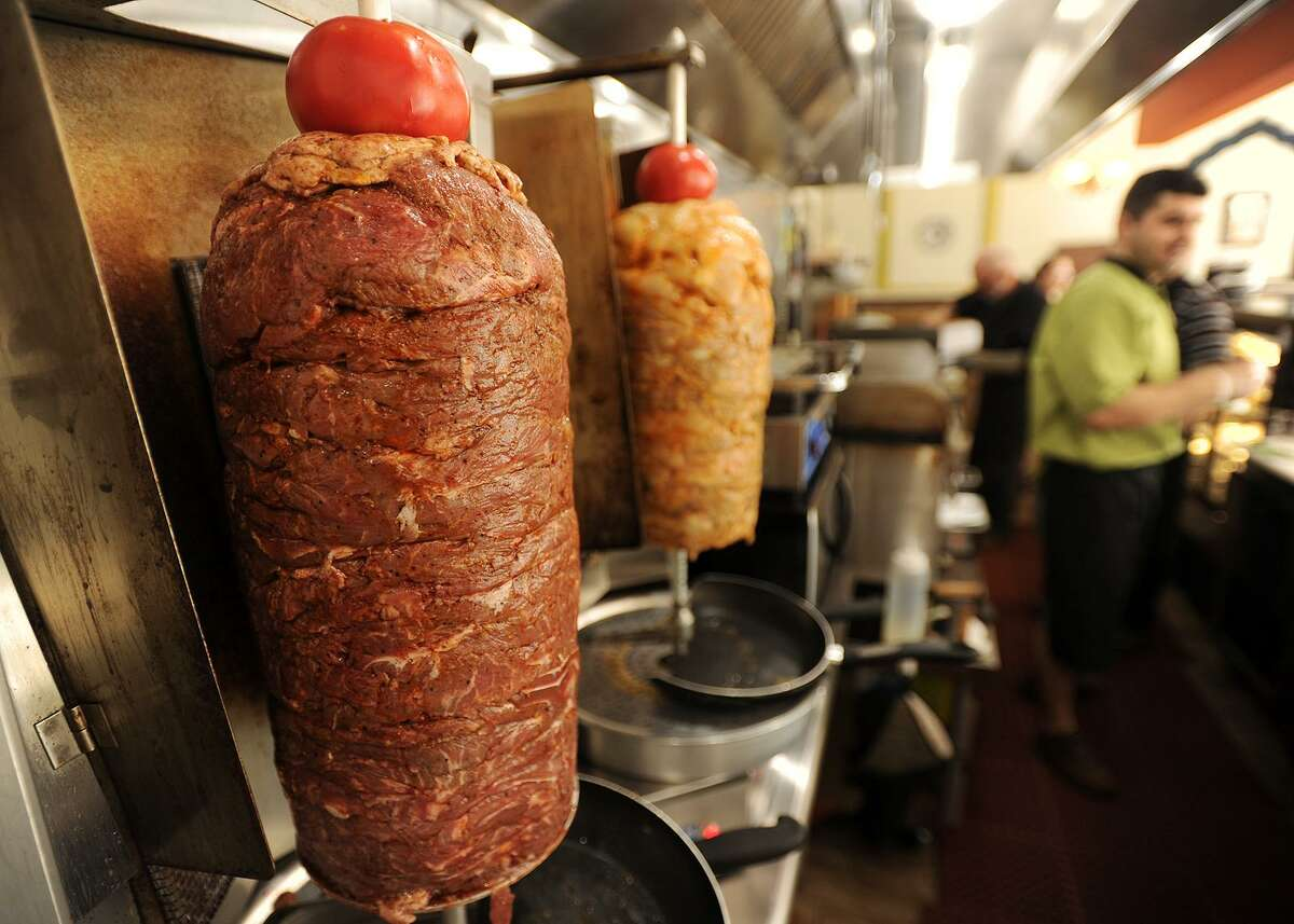 Meat cooks on vertical spits at Flames Mediterranean and American Grill at 12 Daniel Street in Milford, Conn. on Tuesday, June 13, 2017.